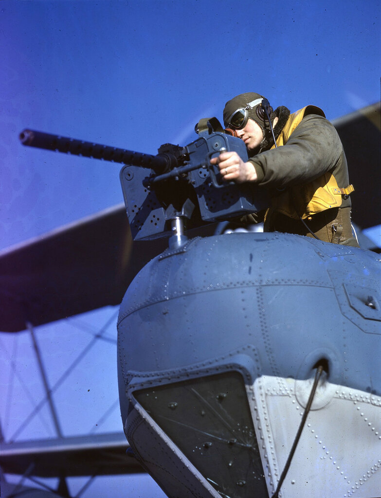 U. S. Coast Guard gunner at his position in the bow of a U. S. Coast Guard Hall PH-3.