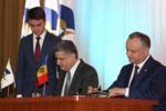 Игорь Додон подписывает меморандум о сотрудничестве с ЕАЭК.png