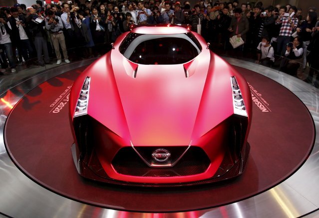 Visitors take pictures of Nissan Motor Co's concept car Nissan Concept 2020 Vision Gran Turismo