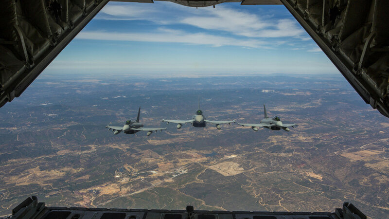 Three Eurofighter Typhoons with the Spanish Air Force escort a U.S. Marine Corps KC-130J Hercules during an aerial refueling mission, Aug. 13, in Spain. Bilateral exercises such as this one are how Spain and the U.S. foster one of the closest defense part