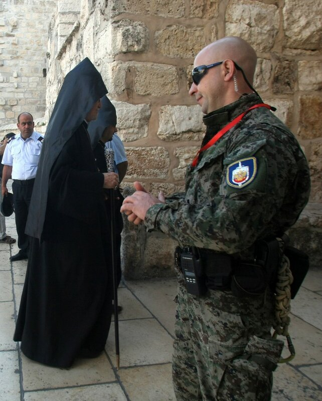 A Russian security guard accompanying Pr