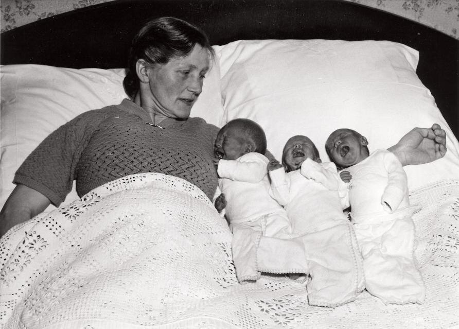 Dutch mother with her triplets. Lieuven, The Netherlands