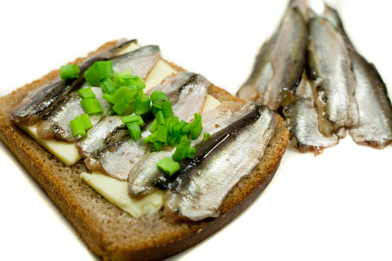 sandwich with fish sprat and spring onions