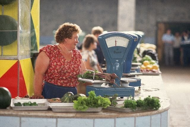 Grocer Weighing Beets at Market in Moscow