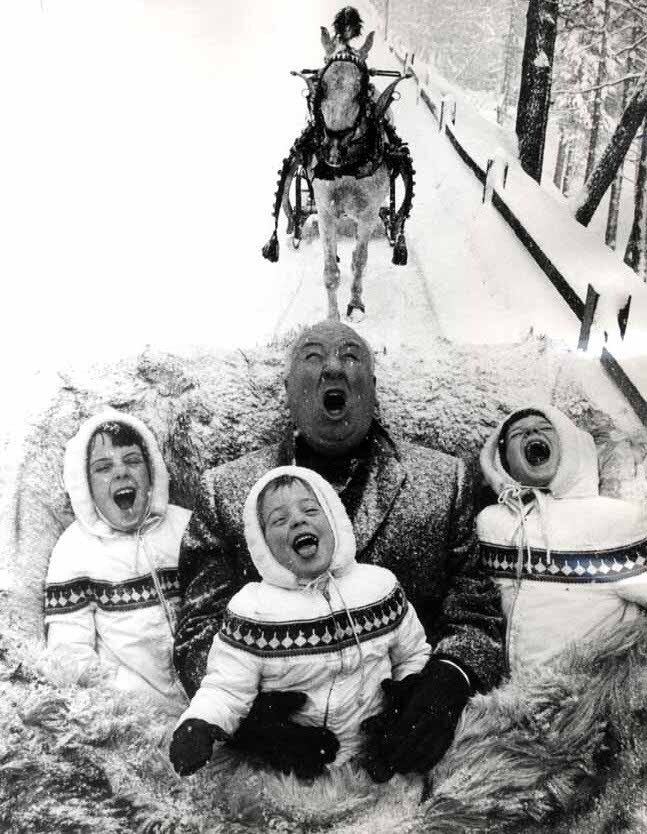 Alfred Hitchcock and 3 children catching snowflakes (1962)