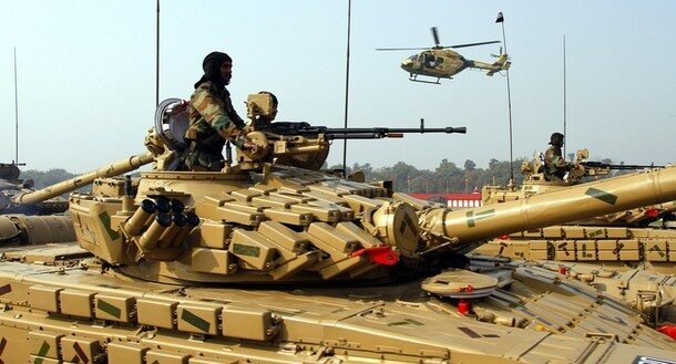 Indian soldiers mounted on army tanks take part in the Army Day parade in New Delhi