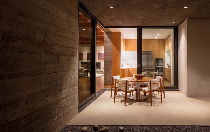 This ridge top house in Santa Fe is organized around two perpendicular board-formed concrete walls.