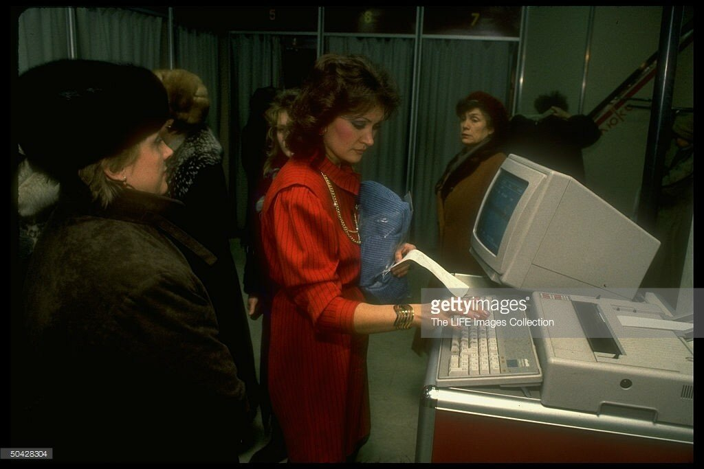 1989 Salesgirl transacting clothing sale, using computer, at Luxe (Lyuks) department store in suburban Moscow.jpg