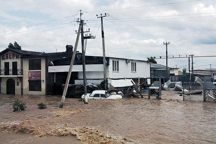 A stranded car on a flooded street in Krymsk