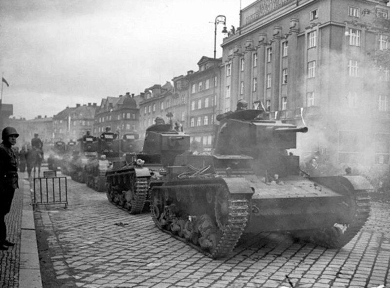 Polish 7TP tanks capture Cesky Tesin (Cieszyn). Left on the sidewalk is a Polish soldier in a helmet Wz. 31