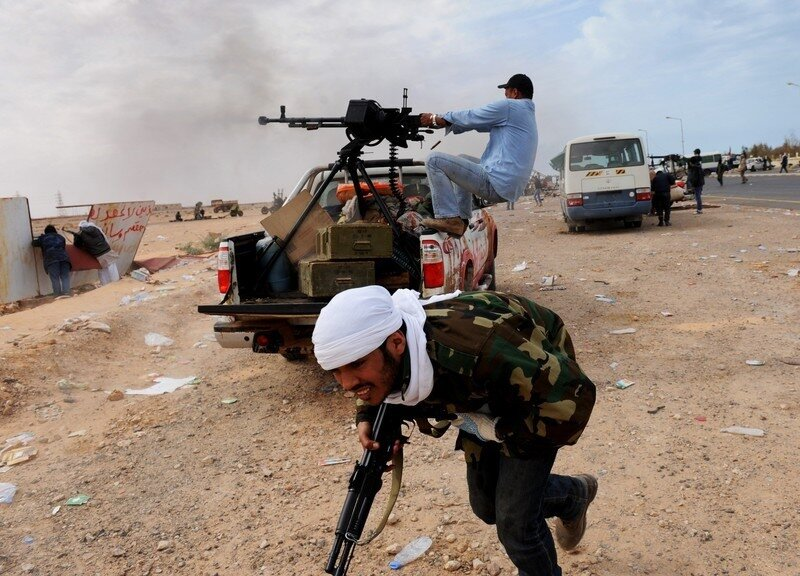 Libyan rebel fighters try to defend a ga