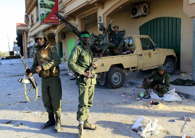 Libyan soldiers loyal to leader Muammar Gaddafi stand in the city of Misrata