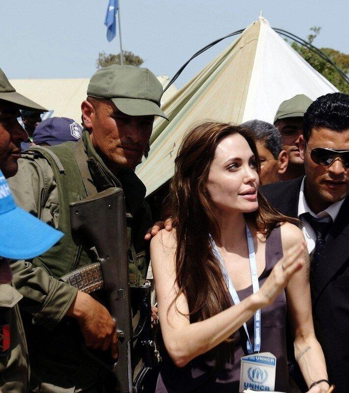 UNHCR Goodwill Ambassador Angelina Jolie waves during her visit to Shousha Camp at Ras Djir