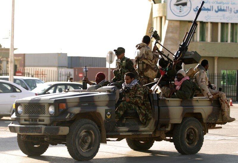 Libyan rebels patrol the eastern coastal