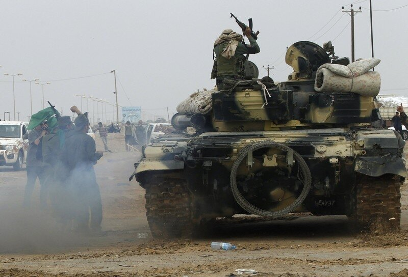 A Libyan government soldier moves a tank at the west gate of  town Ajdabiyah