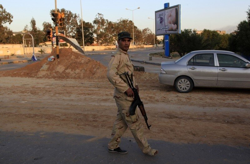 A Libyan soldier walks with an injured foot in the city of Misrata