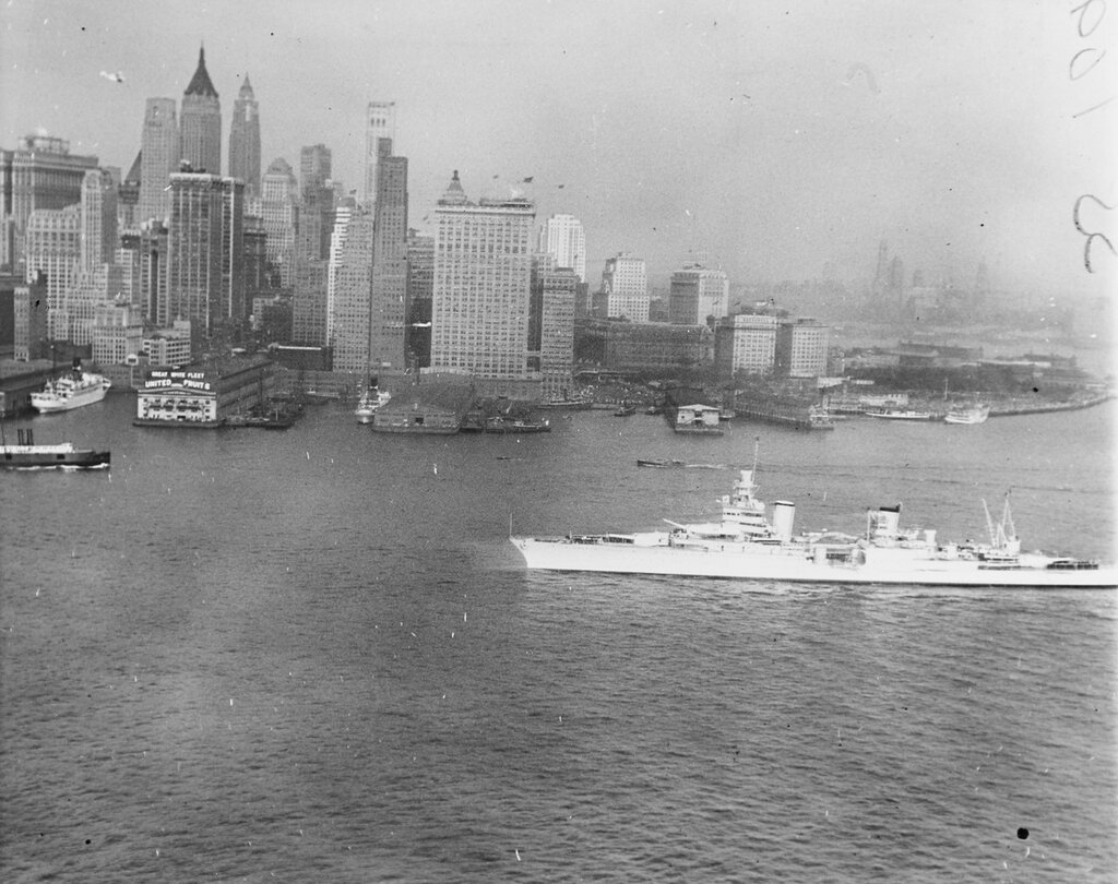 Under the skyline, USS INDIANAPOLIS (CA-35) with President Franklin D. Roosevelt aboard enters the New York harbor during fleet review, 31 May 1934
