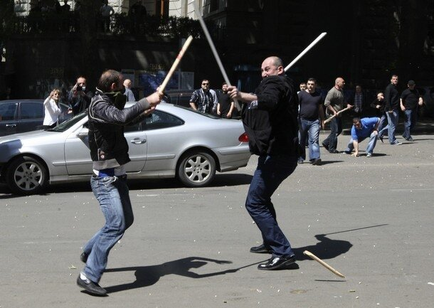 Opposition supporters clash with unidentified men in Tbilisi