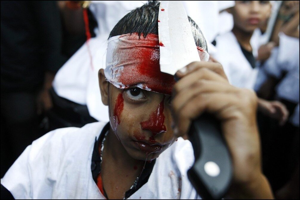 A Muslim boy cuts himself with a knife during a Muharram procession to mark Ashura in Mumbai