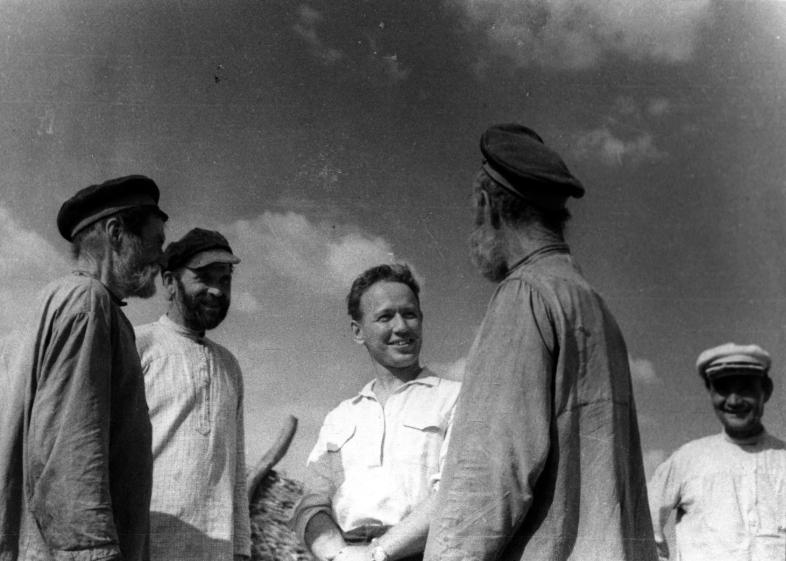 Mikhail Sholokhov speaks with locals during a visit to the countryside, 1938. Photo by Georgy Petrusov..jpg