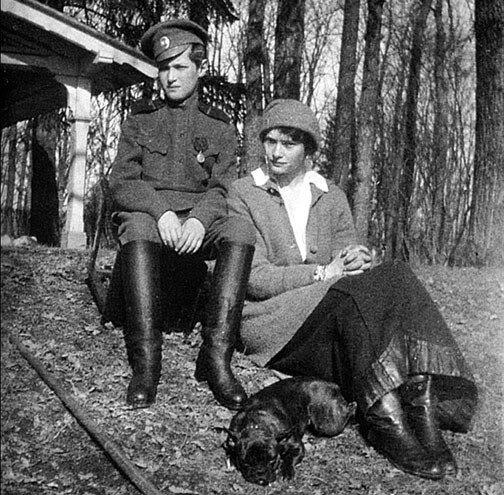 Alexei, Tatiana and her French Bulldog Ortino in the Park at Tsarskoe Selo.