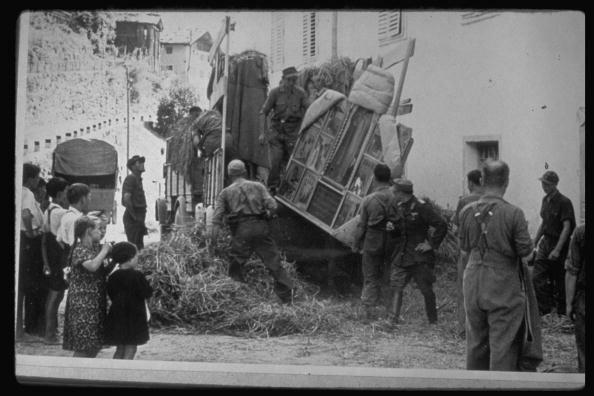 Germans unloading ptgs. taken fr. Uffizi