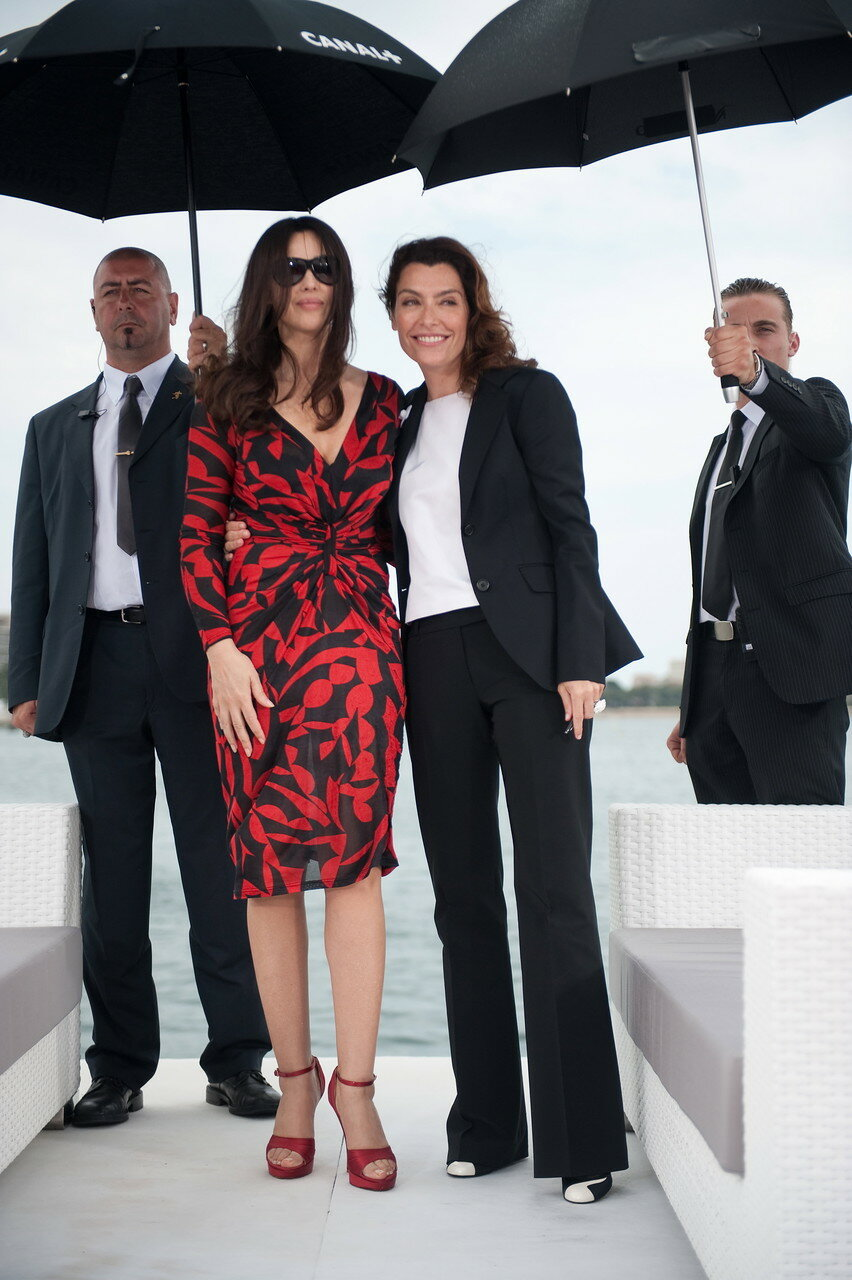 Italian actress Monica Bellucci (L) and French TV host Daphne Roulier