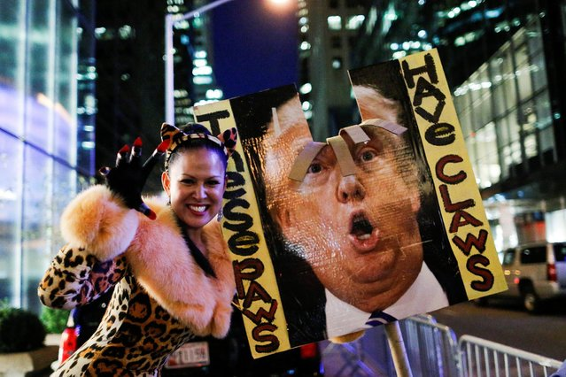 A woman takes part in a protest against Republican presidential nominee Donald Trump and the GOP in