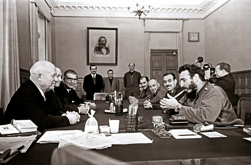 fidel castro lighting a cigar and wearing two rolex watches during a meeting with khrushchev, kremlin, 1963.jpg