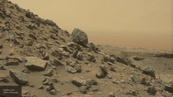 НаМарсе отыскали гигантский космический корабль и«людей вчерном»