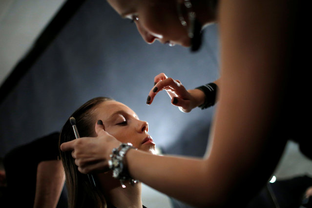 A model has make-up applied backstage at the Tbilisi Fashion Week in Tbilisi, Georgia, October 20, 2