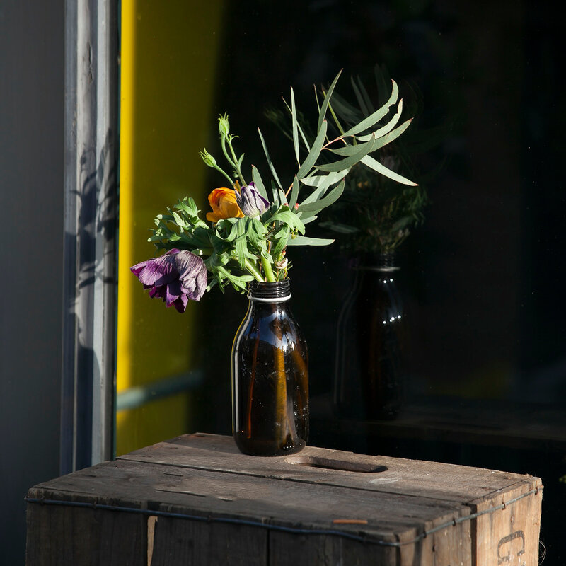 flowers in the old pharmacy bottles adorn storefronts