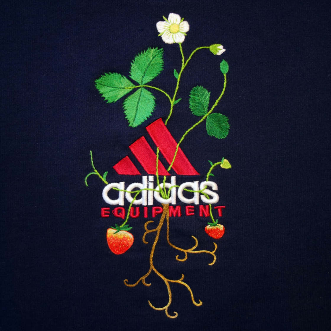 Embroidering flowers over the logos of famous brands