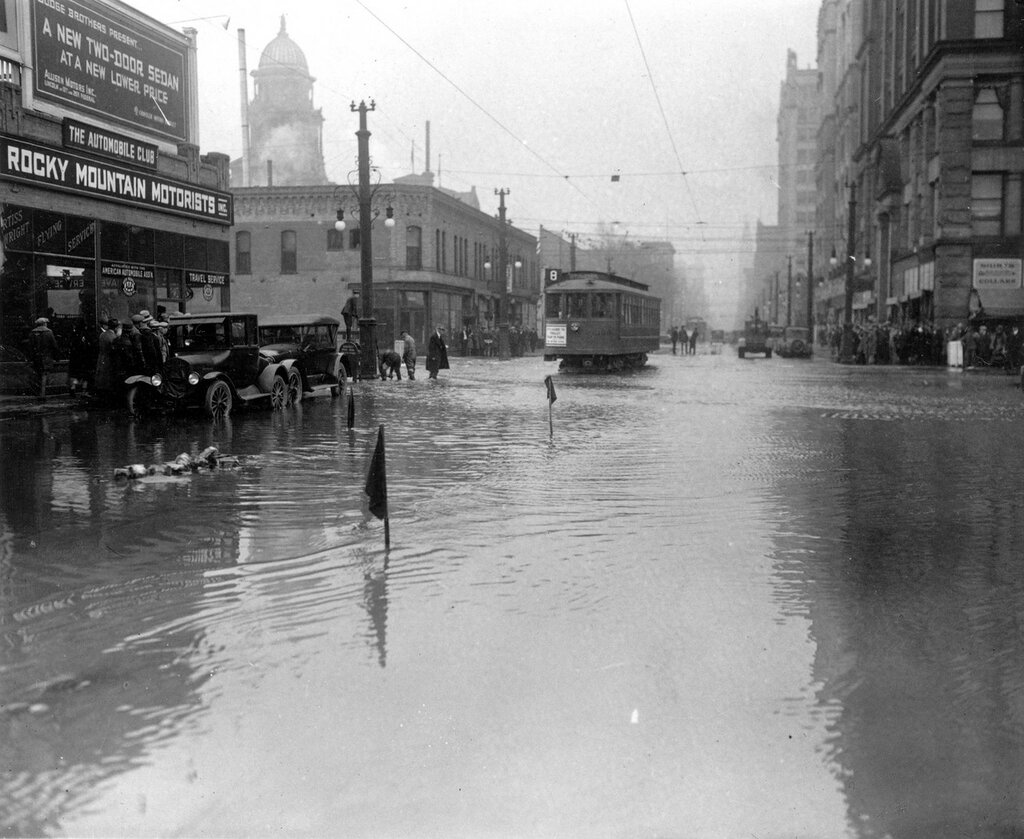 Cherry Creek water floods 16th Street in Denver, Colorado after the Castlewood Canyon Dam break, 1933