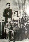 Моя прабабушка Анна и дедушка (сидит).