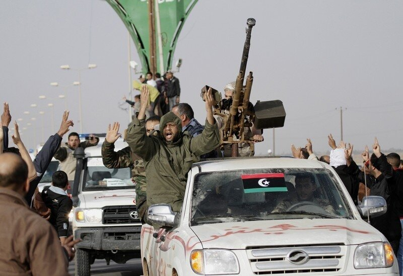 Supporters cheer as a  convoy of Libyan