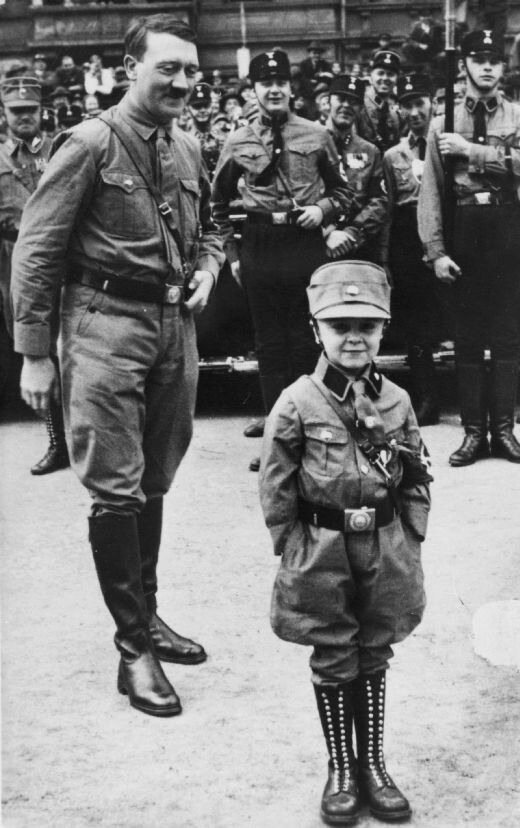 Adolf Hitler and a small boy in storm trooper uniform, Brunswick, October 1931