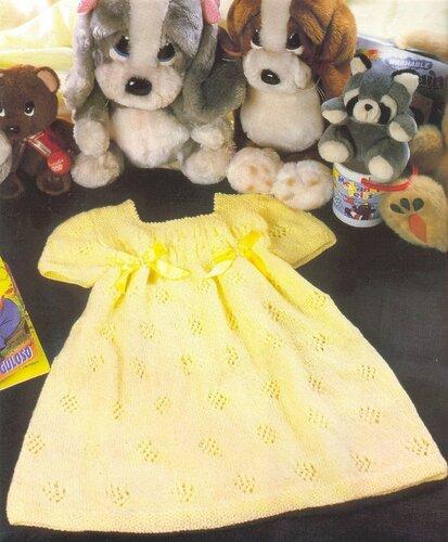 Желтое платье на девочку на 1-2 года, связанное спицами. Подробное описание