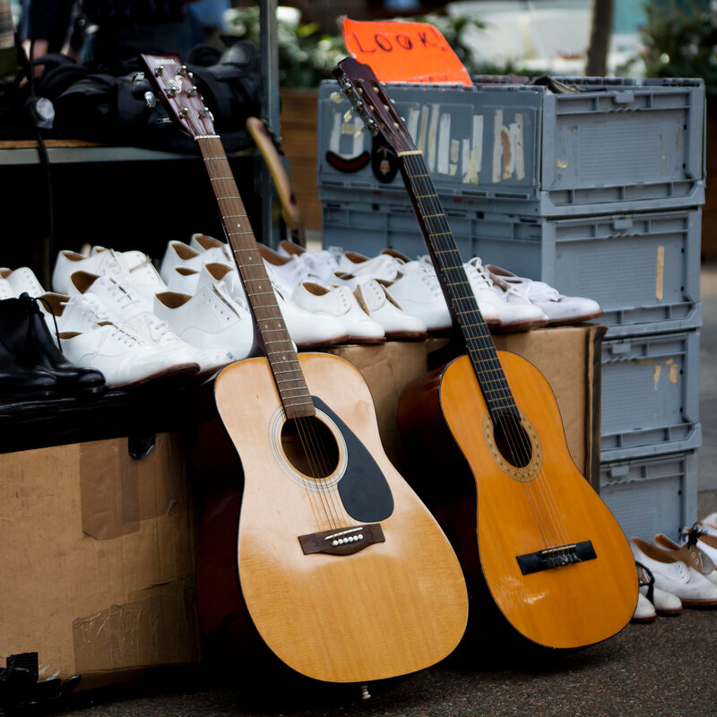 guitars and old shoes on antic market in London