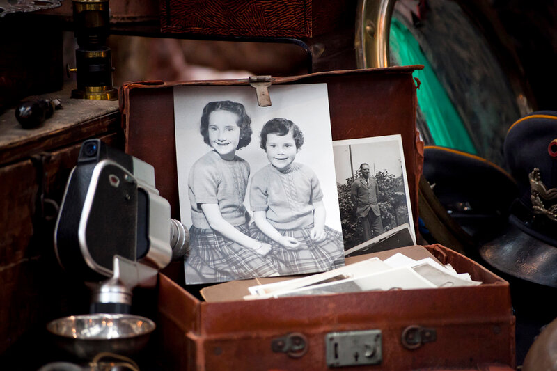 old pictures in vintage suitcase  on street market in London