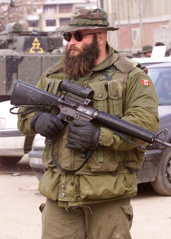 Canadian Soldier stands guard near bridge that divides Mitrovica, Kosovo