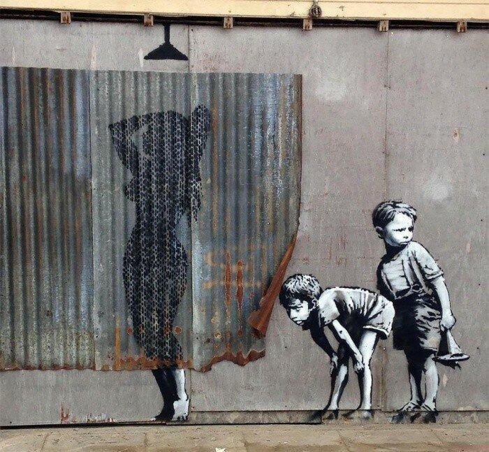 Уличный художник Banksy.