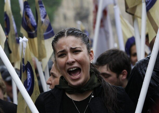 Тбилиси: сегодня - вчера A supporter chants slogans during an opposition rally in central Tbilisi