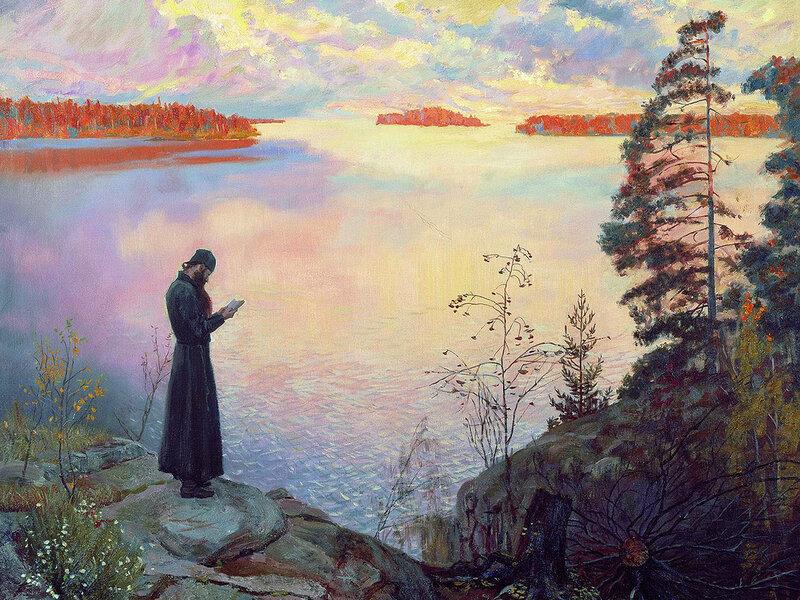 священник у озера с книгой. Осень. Север