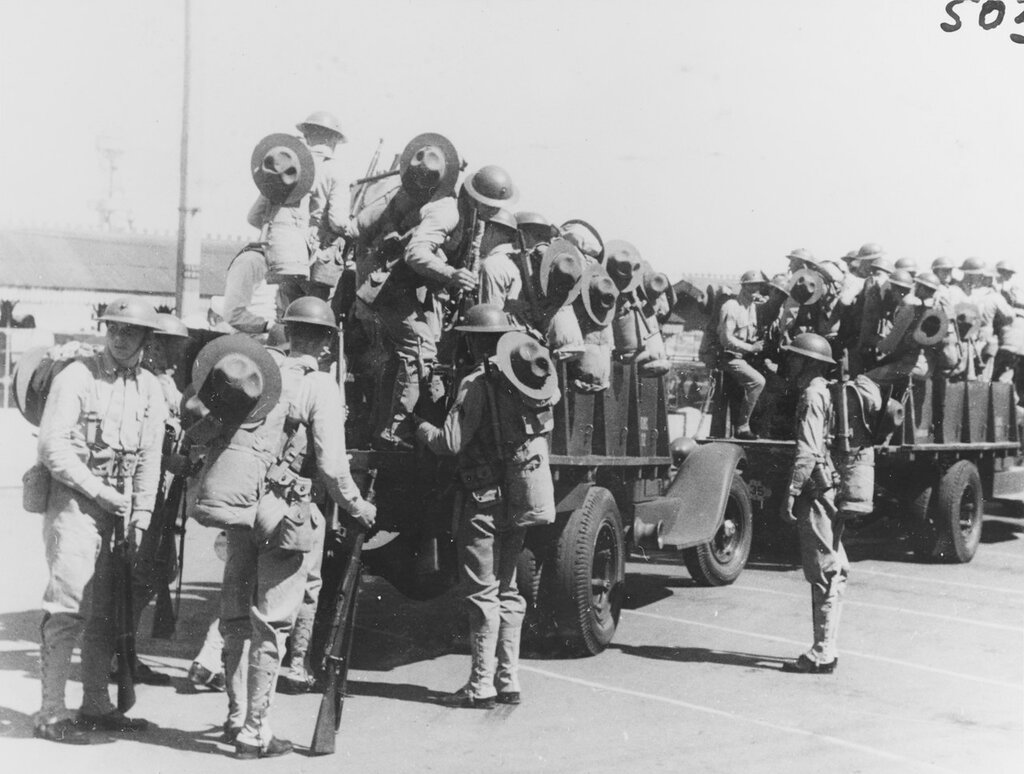 U.S. Marines. Arriving from Cavite in the SS PRESIDENT HOOVER to reinforce the 4th Marines in Shanghai, circa August 1937. Foremast of USS AUGUSTA (CA-31) visible in background. Note Marines' trucks and uniforms, etc.