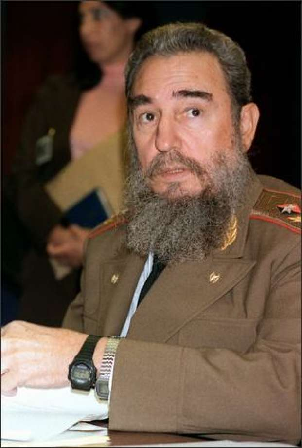 Fidel Castro wears two watches on Sept. 2, 1986 during the 8th Non-Aligned Summit in Harare, Zimbabwe. DOMINIQUE FAGET.jpg