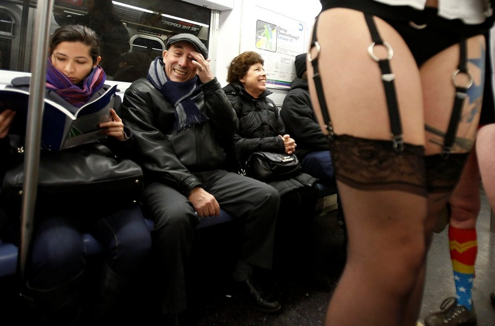 People watch as participants in the No Pants Subway Ride take the 6 train downtown in New York January 13, 2013. The event is an annual flash mob and occurs in different cities around the world, according to its organisers. REUTERS/Carlo Allegri (UNITED S