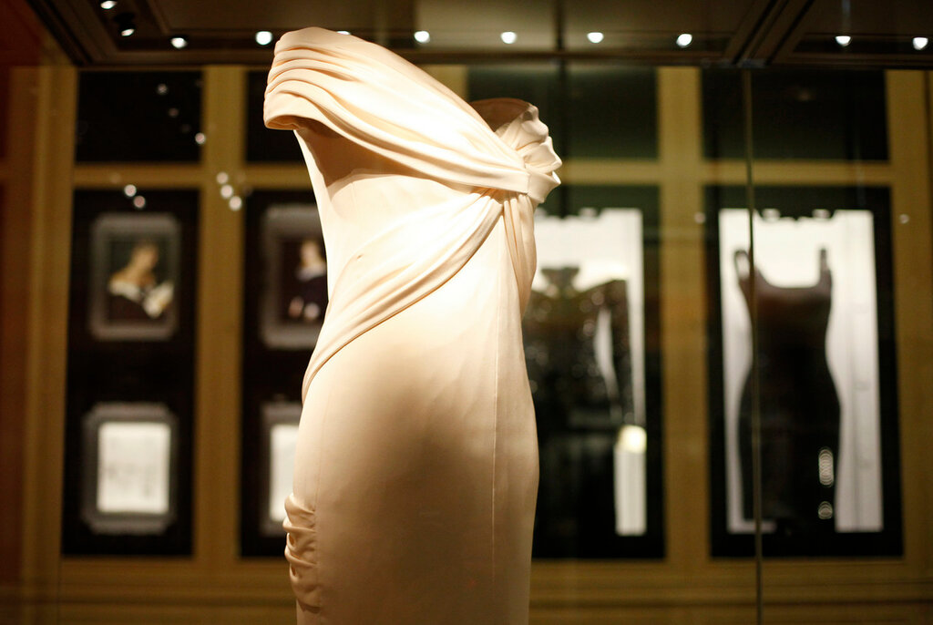 Dresses worn by Princess Diana are displayed in Kensington Palacewhich reopened today after a 12 million pound Sterling (19 million USD) renovation in central London