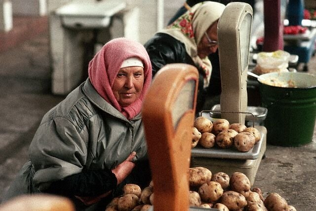 Woman Selling Potatoes at Moscow Market