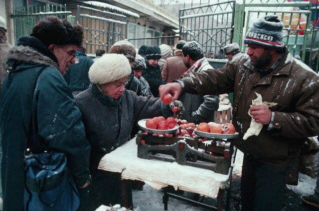 Vendor Selling Tomatoes in Moscow Snow